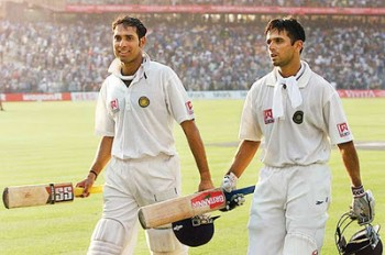 Laxman and Dravid. A bunch of disheartened Australians just out of shot.
