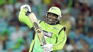 Chris Gayle celebrates reaching double figures