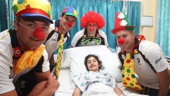 For the guy in the red wig, we imagine it was convenient this photo was taken in a hospital.