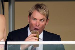Shane Warne, presumably with a glass of freshly-chundered vomit.
