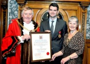 Jimmy Anderson picks up his certificate confirming him Burnley's second sexiest person.